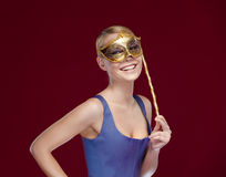 Woman puts on masquerade mask Royalty Free Stock Photography