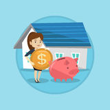 Woman puts money into piggy bank for buying house. Stock Image