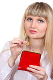 A woman puts money in the purse Stock Photography