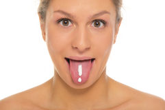 Woman puts out tongue with drawn exclamation mark royalty free stock images
