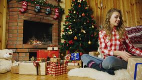 Woman puts presents under the Christmas tree stock footage