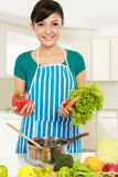 Woman Putting A Bunch Of Healthy Ingredients Royalty Free Stock Images