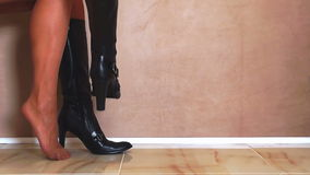 Woman Putting on Black Boots. And Walking Away stock footage