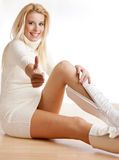 Woman putting on boots royalty free stock photography