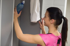 Woman putting bottle in locker at gym Royalty Free Stock Image