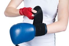 Woman is putting on boxing glove Stock Image