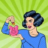 Woman Putting a Coin Into a Money Box. Pop Art Royalty Free Stock Image