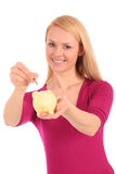 Woman putting coin in piggy bank royalty free stock photo
