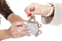 Woman putting a coin on the purse Royalty Free Stock Images