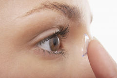 Woman Putting In Contact Lens Royalty Free Stock Images