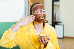 Woman  putting cosmetic on face Royalty Free Stock Images