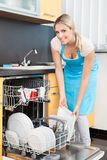 Woman Putting Dishes In The Dishwasher Stock Images