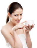 Woman putting on emollient cream on her nose Stock Photo