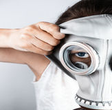 Woman putting on gas mask Stock Image