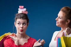Woman putting gifts on friend`s head Stock Images
