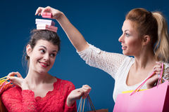 Woman putting gifts on friend`s head Royalty Free Stock Photography