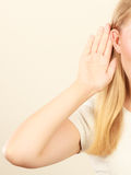 Woman putting hand ear to hear better Royalty Free Stock Photos