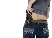 Woman Putting Hand Gun on her Hip Holster Royalty Free Stock Photo