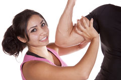 Woman putting hands around mans arm Stock Image