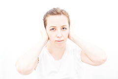 Woman putting hands to her ears Stock Photo