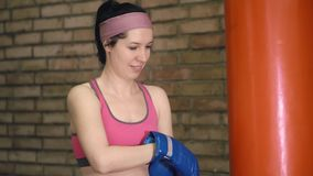 Woman putting on her boxing gloves stock video footage