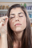 Woman putting on her eyes make up Royalty Free Stock Photo