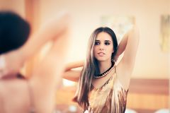 Woman Putting on Her Necklace Preparing for Party Royalty Free Stock Photo