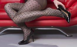 Woman putting on high heel shoe Stock Photos