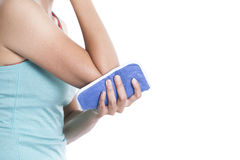 Woman putting an ice pack on her elbow pain Stock Photography
