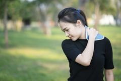 Woman putting an ice pack on her neck pain. Healthy concept stock photo