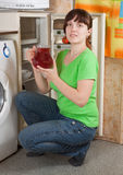 Woman putting jug into refrigerator Stock Photos