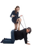 Woman putting leg on man in jacket Stock Image