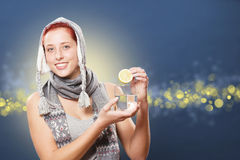 Woman putting lemon in water Stock Images