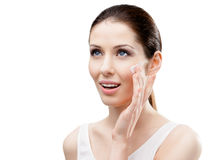Woman applying lifting cream on her face Royalty Free Stock Image