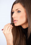 Woman putting on lip liner Stock Image