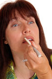 Woman putting lipstick on her lipsD1:J37. Royalty Free Stock Photo