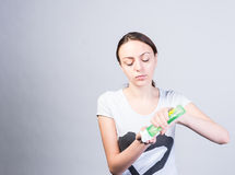 Woman Putting Liquid Facial Cleanser on a Cotton Royalty Free Stock Photography