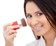 Woman putting make up Stock Photo