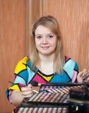 Woman putting make up Stock Photography