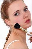Woman putting make up on Stock Photography