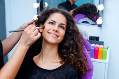 Woman putting make up Stock Image