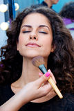 Woman putting make up Royalty Free Stock Photo