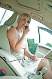 Woman putting make up in the car Royalty Free Stock Image