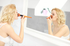 Woman putting on make up Royalty Free Stock Photo