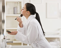 Woman Putting on Makeup Stock Photo