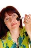 Woman putting makeup on her chic's. Royalty Free Stock Image