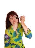 Woman putting on makeup. Stock Photo