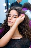 Woman putting mascara make up Royalty Free Stock Image