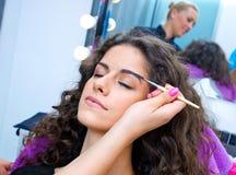 Woman putting mascara make up Stock Photos