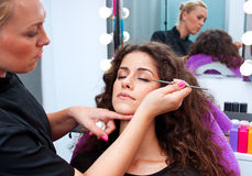 Woman putting mascara make up Royalty Free Stock Image